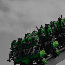 Green roller coaster with screaming people